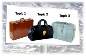 "Billboard image of three suitcases labeled: ""Topic 1, Topic 2, Topic 3"""
