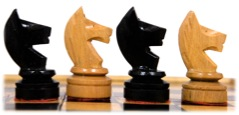 Small chess pieces standing in line