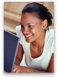 Woman happily using her laptop