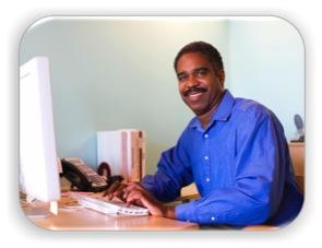 Entrepreneur sitting at a computer