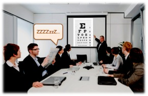Presenter projecting an optometric eye chart on the screen that is putting people to sleep