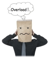 "A man with a bag over his head thinking ""Overload!"""