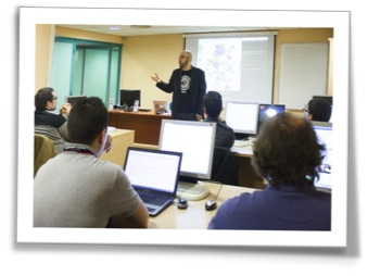 Instructor teaching a class of computer users