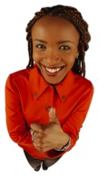 """Woman smiling and giving a """"thumbs up"""""""